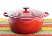 stock photo of dutch oven  - New and shinny red dutch oven with lid on - JPG