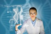 stock photo of scientist  - Woman scientist touching DNA molecule image at media screen - JPG