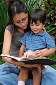 picture of babysitter  - Beautiful Hispanic mother reading to her son - JPG