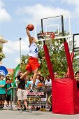 Young Man Leaps High In Outdoor Slam Dunk Contest