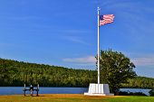 image of fanny  - Flagpole and cannon with the beautiful blue waters of Lake Fanny Hoe - JPG