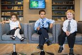 Three children in the clothing business in a business center, focus on the boy in the center