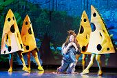 MOSCOW - DEC 15: Actors in roles of Ben Gunn and pieces of cheese on stage at Big Concert Hall Izmai