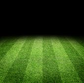 stock photo of grass area  - Close up of soccer or football field at night with copy space - JPG