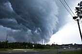stock photo of rain clouds  - tornado forming from wall cloud in central florida - JPG