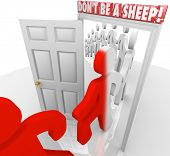 The words Don't Be a Sheep above a doorway as people march through and are changed, warning you to be independent, non-conformist and self-reliant