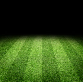 stock photo of football pitch  - Close up of soccer or football field at night with copy space - JPG