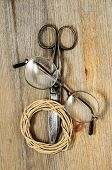 Old Scissors, Glasses And Hank Of Packthread On Wooden Background