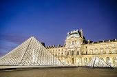 PARIS - AUGUST 18: Louvre museum at sunset on August 18, 2012 in Paris. Annual Summer Exhibition at