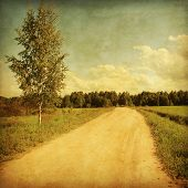 Country road in grunge and retro style.