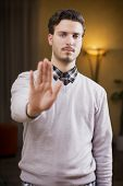 Handsome, Seerious Young Man Doing Stop Sign With Hand