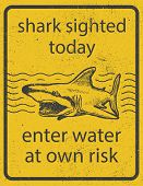Grunge shark attack warning sign vector eps 8