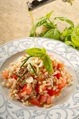 spelt salad with sliced tomatoes