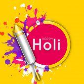 Indian festival Happy Holi celebrations concept with colour gun on splash background.