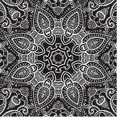 Lace background. White on black. Mandala.