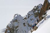 Unidentified climbers at the mountain top station of the Aiguille du Midi 3842 m in French Alps