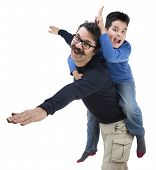 Happy portrait of the father and son of ten years isolated on white background