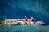 Vintage retro hipster style travel image of St. Bartholomew's Church, Berchtesgaden, Bavaria, Germany