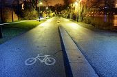 stock photo of bike path  - bike path in the park night city Helsinki Finland - JPG