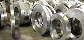stock photo of tin man  - sheet tin metal rolls in production hall