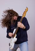 Rock Musician With Expression Playing Electric Bass Guitar