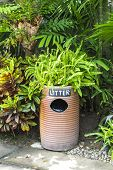 Earthenware Litter Bin With Green Plant