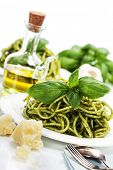 pic of pesto sauce  - delicious italian pasta with pesto sauce over white - JPG