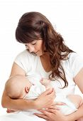 pic of feeding  - young mother breast feeding her infant baby - JPG