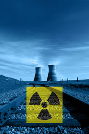 pic of reactor  - Nuclear reactor cooling towers in blue rail line and international nuclear radiation hazard symbol - JPG