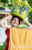 Woman Holding Laundry Basket On Her Head