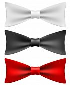 White, black and red bow ties isolated on white background.