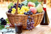 Grapes in wicker basket and red wine