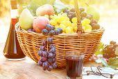 Autumn harvest in wicker basket and wine
