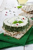 stock photo of collate  - ?old collation: Crisp bread and cheese with French Provencals herbs - JPG