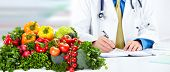 picture of doctors office  - Nutritionist doctor man with vegetables working in the office - JPG