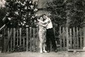 SIERADZ, POLAND - CIRCA FIFTIES: vintage photo of couple in garden