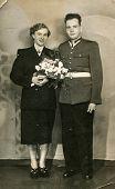 SIERADZ, POLAND, MAY 5, 1955 - vintage photo of newlyweds (groom in military uniform)