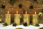 Four Golden Burning Candles For Advent On Wooden Rustic Background.