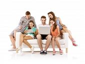 Group of young people on sofa with tablet