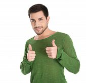 Happy Isolated Young Man In Green Pullover Making Thumb Up Gesture.
