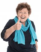 Happy Isolated Older Lady Wearing Blue Clothes With Thumb Up Gesture Over White.