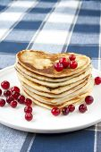 Heart Shaped Pancakes With Cranberries On Porcelain Plate. Closeup.