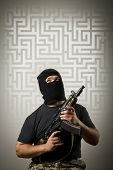 stock photo of crime solving  - Man in mask with gun solving maze - JPG