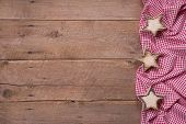 Wooden Background With Stars And A Red Checkered Frame For Christmas Or For A Greeting Card