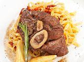 tasty steak with pasta