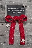 Chalk Board With Merry Christmas Message , Santa And Snowflakes On Wooden Background With German Tex
