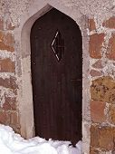 Old Arched Church Door At Winter Time
