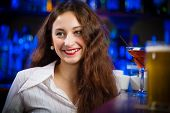 young woman in a bar