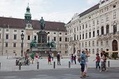 Tourists on Palace of Hofburg in Vienna