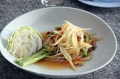 image of green papaya salad  - green papaya salad in white dish on the foods table - JPG